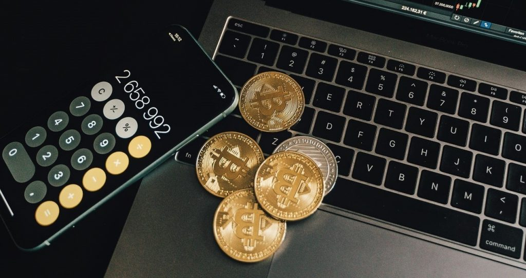 bitcoins, a laptop and a phone